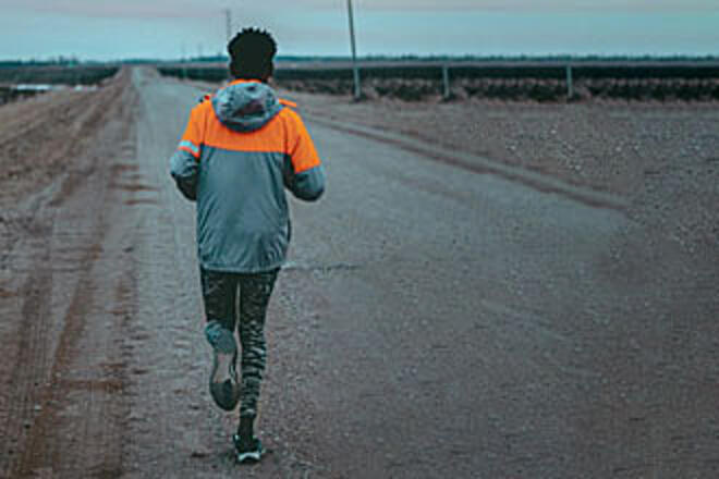 A person out for a run on a dirt road