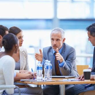 Man talking durant a meeting